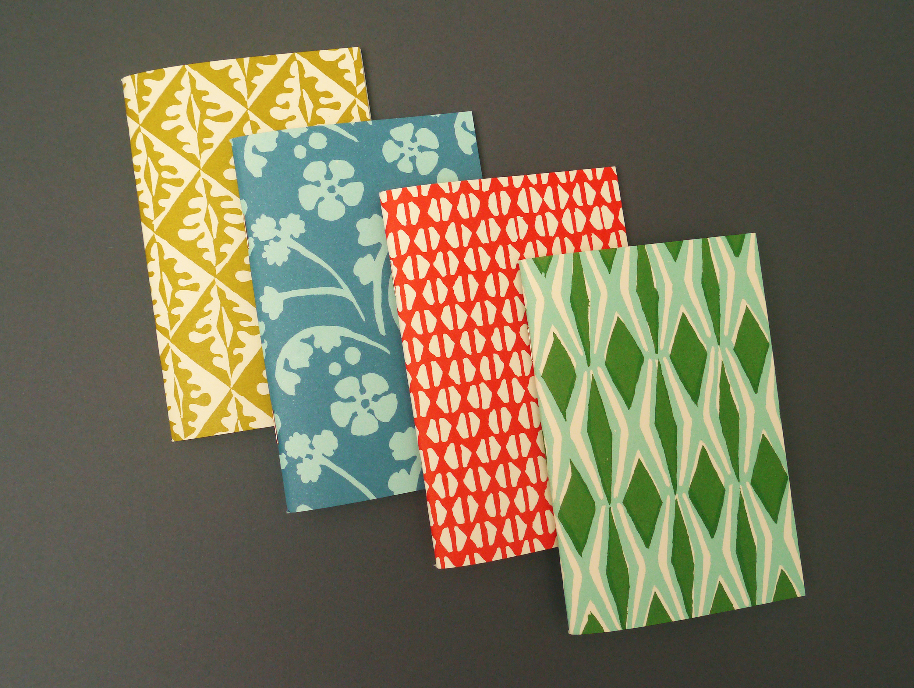 Four colourful notebooks